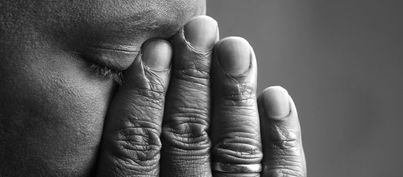 head in hand during drug detox